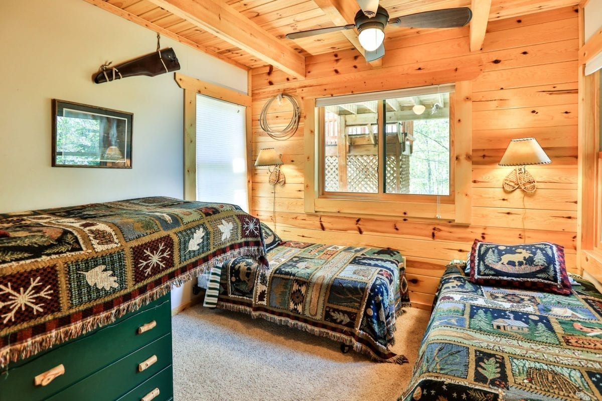 Yellowstone Lodge bedroom with two beds.
