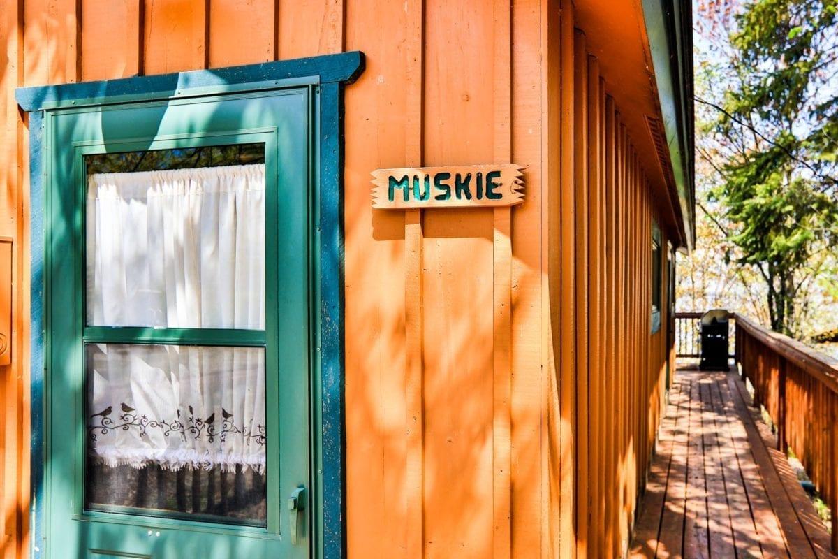 Muskie cabin exterior and front door.