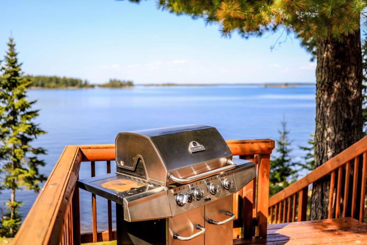 Yellowstone Lodge patio with view of Lake Kabetogama and gas grill.