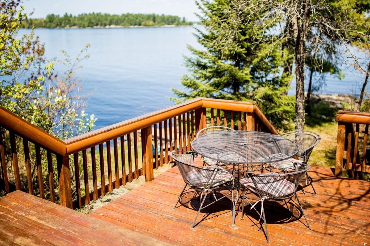 Muskie Lodge patio with table and view of Lake Kabetogama.