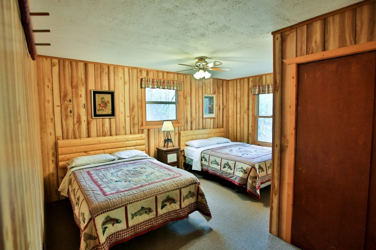 Caribou Cabin bedroom with two beds.