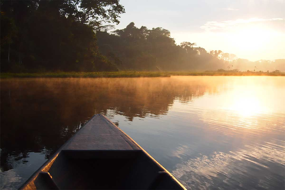 Canoe in the lake at sunset.