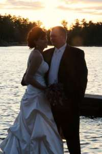 Bride and Groom on the dock at sunset.