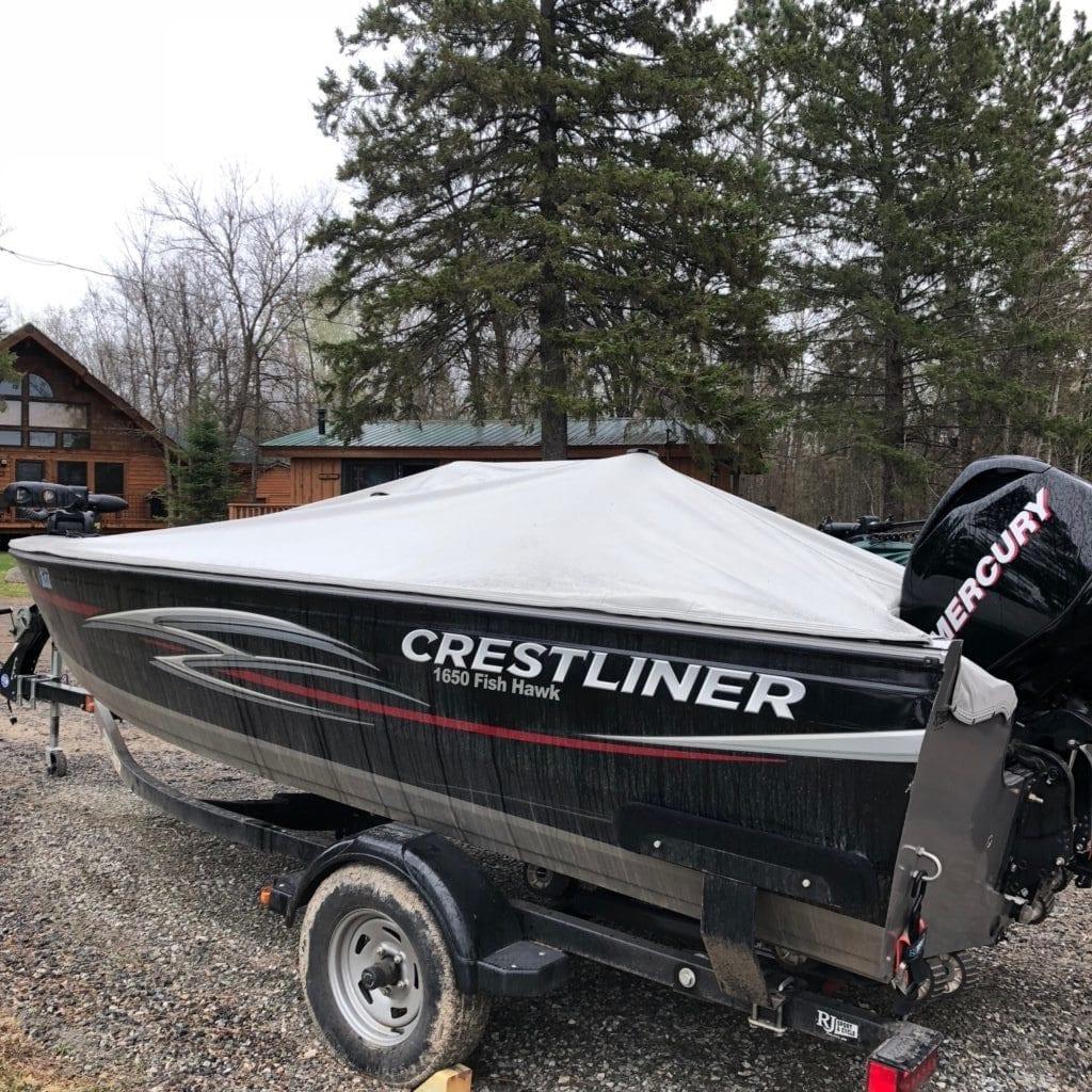 Crestliner boat on a trailer.