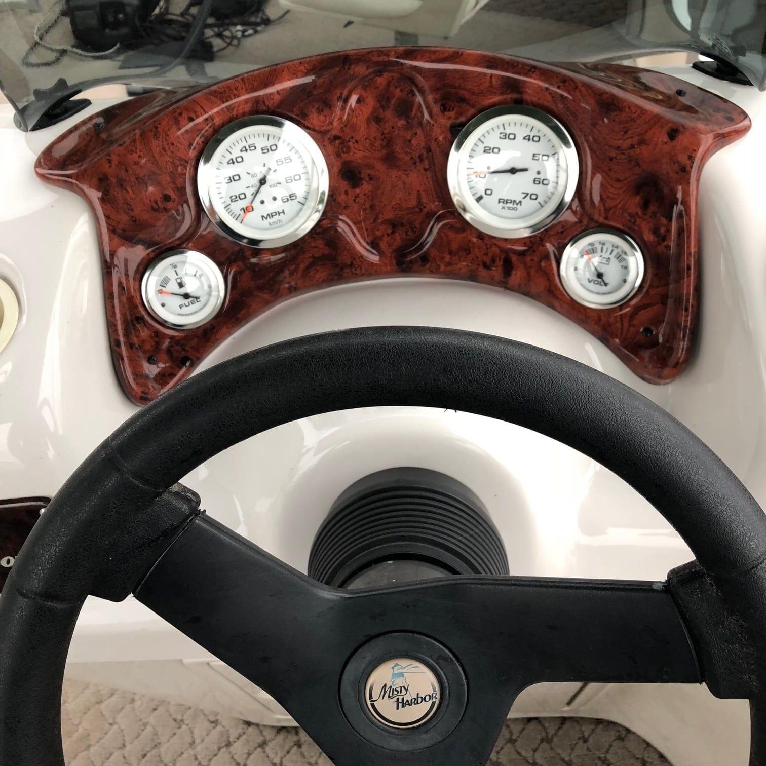 Boat steering wheel and dashboard.