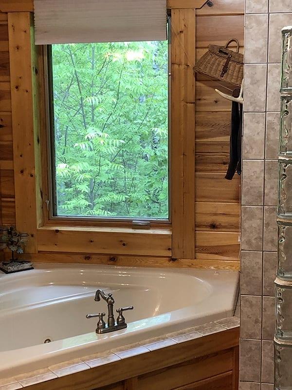 Treehouse cabin bathroom tub.